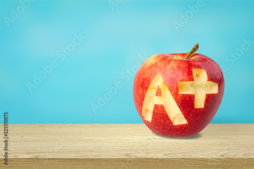 Photo of red apple with A+ on