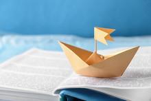 Origami Boat On Open Book, Closeup