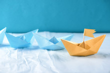 Origami Boats On Crumpled Paper