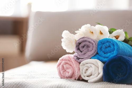 Foto op Canvas Spa Rolled clean towels on bed