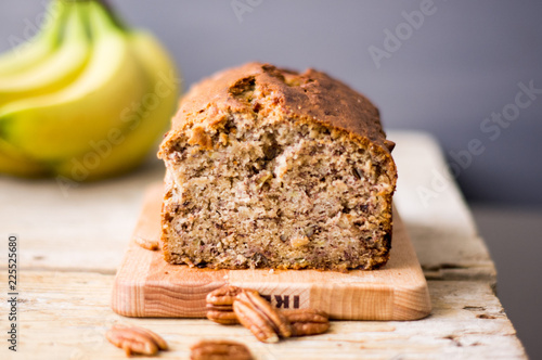 Photographie Banana bread loaf with pecans on a wooden table
