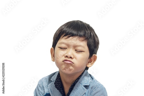 Photo Asian boy is making expression isolated over white