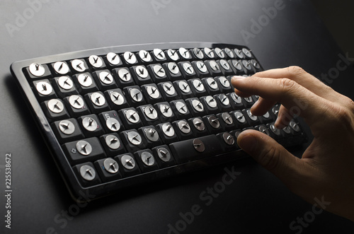 Valokuva  Hands above the keyboard with paper clips