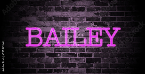 фотография  first name Bailey in pink neon on brick wall