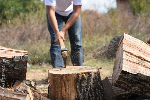 Lumberjack Chopping Wood For Winter Young Man Chopping Woods With