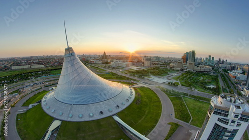 Elevated view with sunrise over the city center with Khan Shatyr and central bus Canvas Print