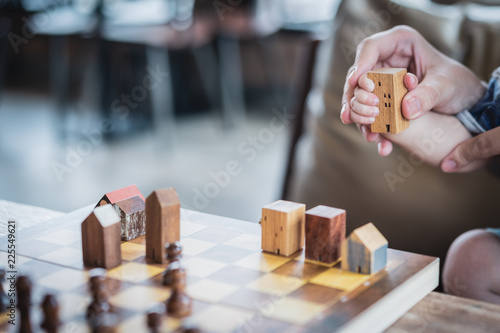 Fotografie, Obraz  Baby Hands holding a house model with mother hand