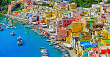 View Of The Port Of Corricella With Lots Of Colorful Houses On A Sunny Day In Procida Island, Italy.