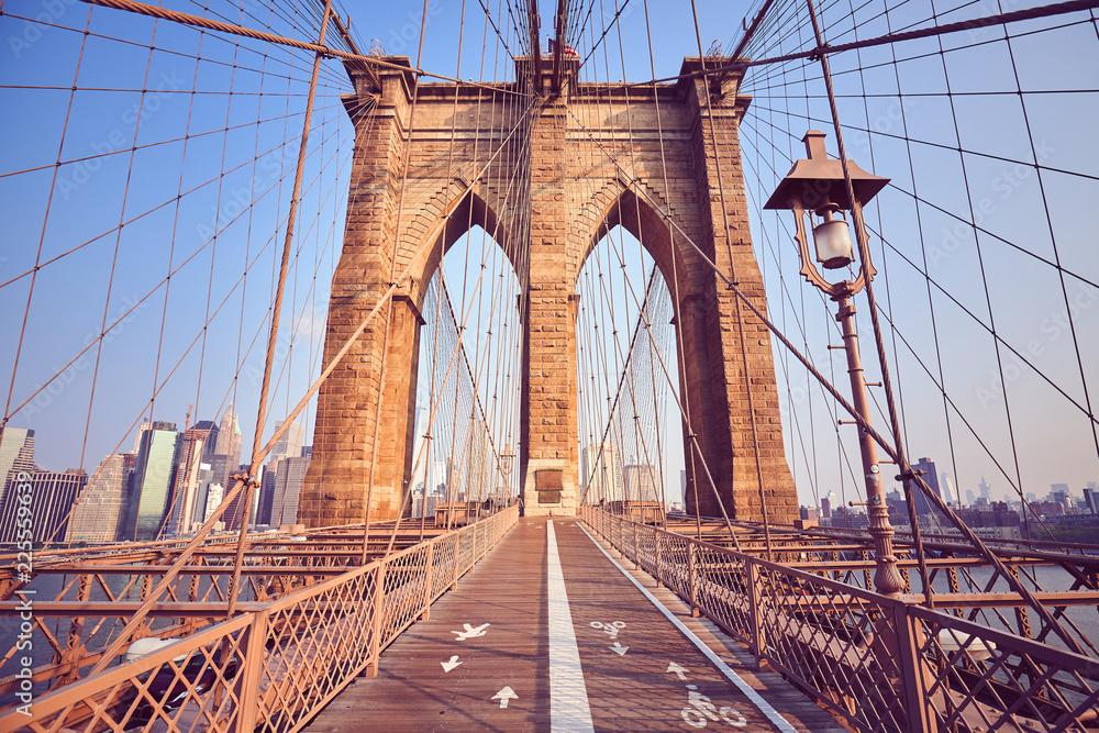Fototapeta Vintage toned picture of the Brooklyn Bridge at sunrise, New York, USA.