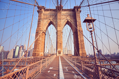 Vintage toned picture of the Brooklyn Bridge at sunrise, New York, USA.