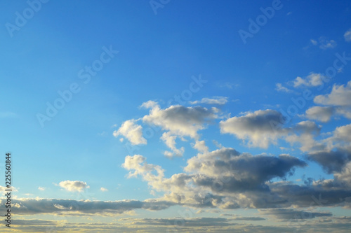 Fotografie, Obraz  Light white clouds high in a blue sky on a sunny day background