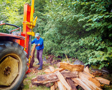 Man Using Log Splitter Machine...