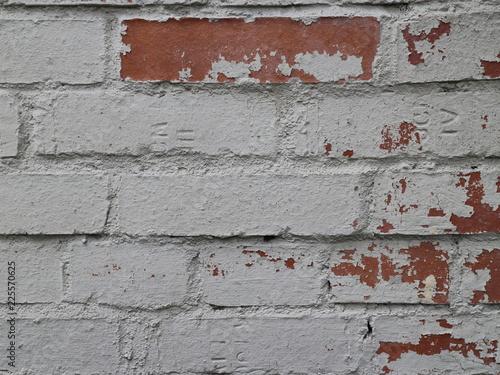 Foto op Canvas Stenen peeling brick wall close up
