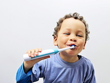 Little Boy Brushing His Teeth With An Electric Tooth Brush With People Stock Image Stock Photo