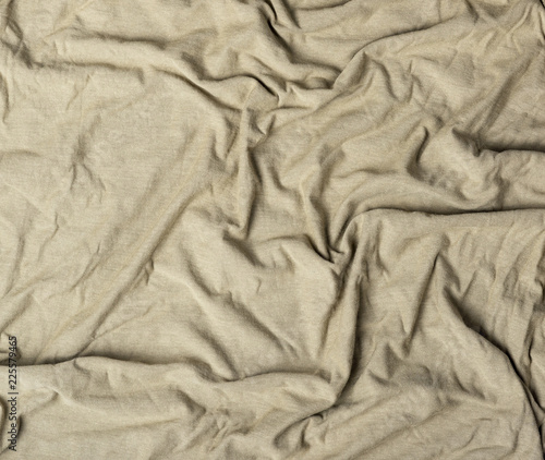 Fotobehang Stof crumpled cotton fabric of gray color, abstract background