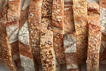 Macro Photo Of Different Pieces Of Fresh Bread With Flax Seeds And Sesame Seeds. Healthy Food. Flat Lay