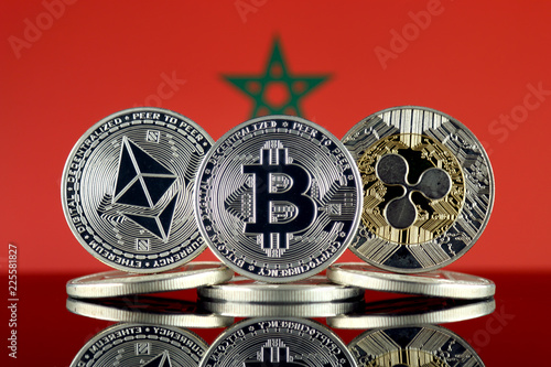 Foto op Plexiglas Marokko Physical version of Ethereum (ETH), Bitcoin (BTC), Ripple (XRP) and Morocco Flag. The Top 3 Cryptocurrencies by Market Cap.