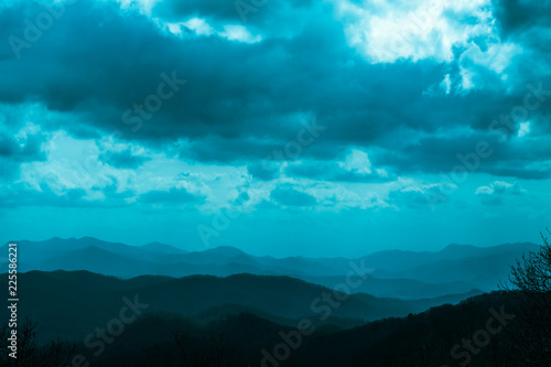 VIEW OF LAYERS OF MOUNTAIN AND DARK CLOUD IN BLUE RIDGE PARK WAY, NORTH CAROLINA Canvas Print