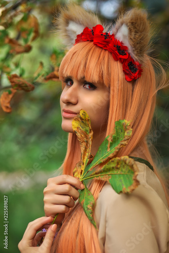 Fotografija  Wolf girl cosplay character in autumn park. Anime festival