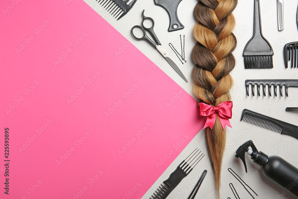 Fototapety, obrazy: Flat lay composition with braid, hairdresser's tools and space for text on color background