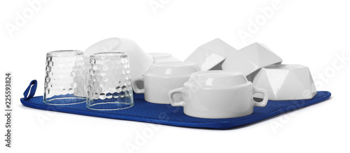 Clean tableware on towel against white background. Washing dishes