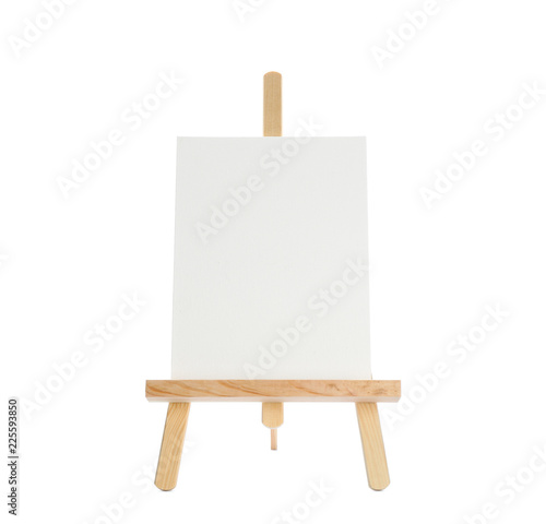 Wooden easel with blank sheet of paper on white background Wallpaper Mural