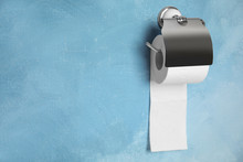 Toilet Paper Holder With Roll On Color Background. Space For Text