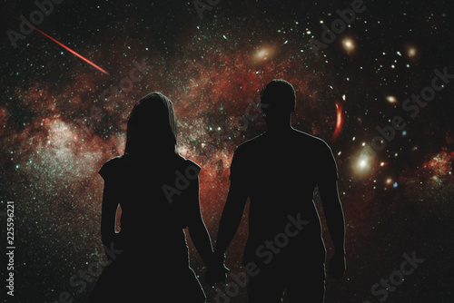 Silhouettes of people who look at the wonderful night sky. Illustration of a lovers' pair, which holds hands and watches the stars. The concept of love and space.