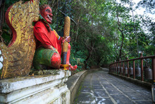 Giant Gate Guardian At Temple Entrance  To Wat Phra That Doi Tung, Chiang Rai, Thailand. Thai Travel Tourism.