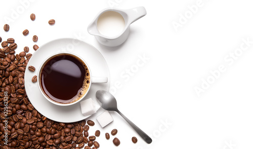 Roasted coffee beans and cup of black coffee