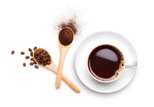 Coffee Beans And Ground Coffee On Wooden Spoon With Cup Of Black Coffee