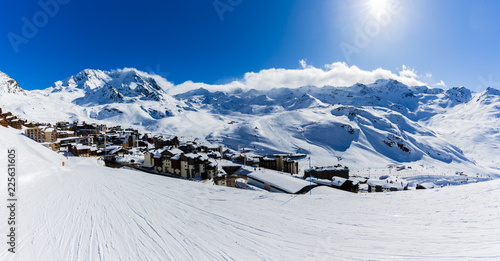 Ski in winter season, view from ski run at Val Thorens and mountains in sunny day in France.