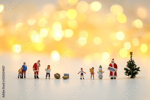 Merry christmas and happy new year Miniature People : Children with Santa Claus doll and his reindeer isolated on white background,in Christmas festival.