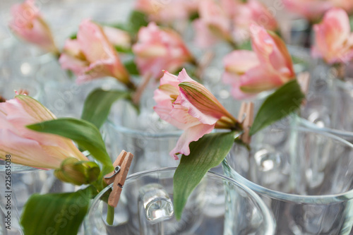 Closeup of tender flowers decoration on wineglass at corporate event