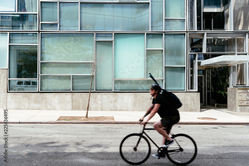 Photo  Cyclist riding against minimalist style building NYC