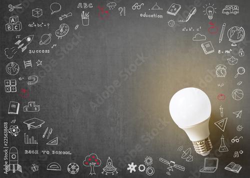 Fotografiet  Innovative creative idea concept with LED lightbulb and school doodle on black s