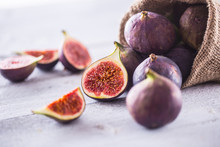 A Few Figs Freely Lying On Old Wooden Table