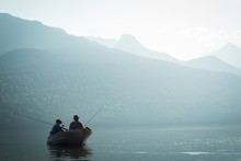 Two Fishermen Fishing In The R...