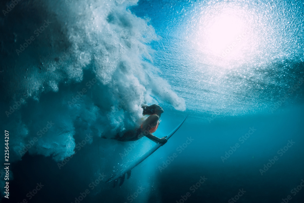 Fototapety, obrazy: Surfer girl with surfboard dive underwater with under big ocean wave.