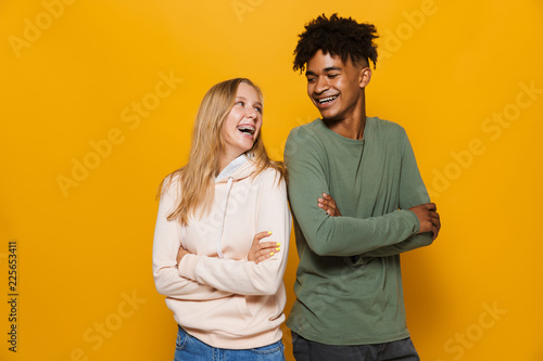 Photo of teenage people man and woman 16-18 with dental braces smiling, isolated Wallpaper Mural