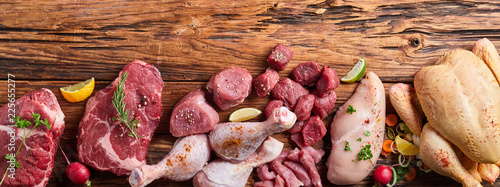 Fototapeta Assortment of raw meat on wooden table obraz