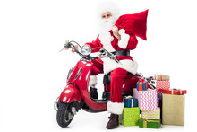 Santa Claus In Costume Holding...