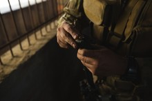 Military Soldiers Loading Bullets In Magazine