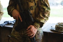 Military Soldier Standing With Rifle During Military Training