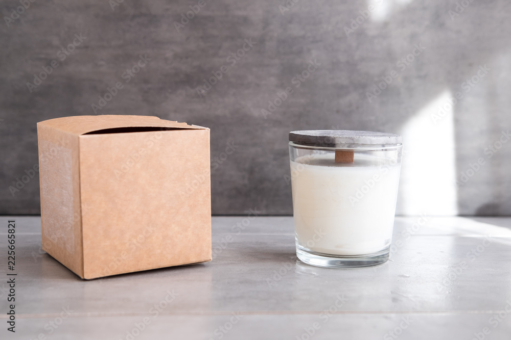 Fototapety, obrazy: Concrete scented soy round candle on grey table