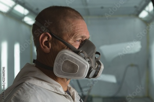 Mechanic with gas mask in garage