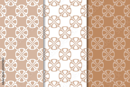 Set of floral ornaments. Brown, beige and white seamless patterns