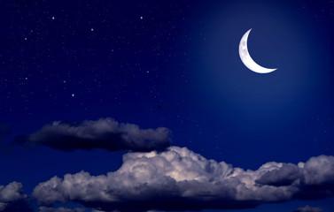 Obraz na płótnie Canvas Stars, moon and cumulonimbus in the night sky