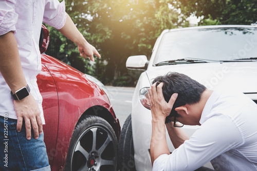 Two drivers man arguing after a car traffic accident collision, Traffic Accident Canvas Print