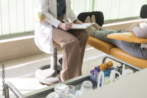 A Doctor Taking the Anamnesis from a Patient Canvas Print
